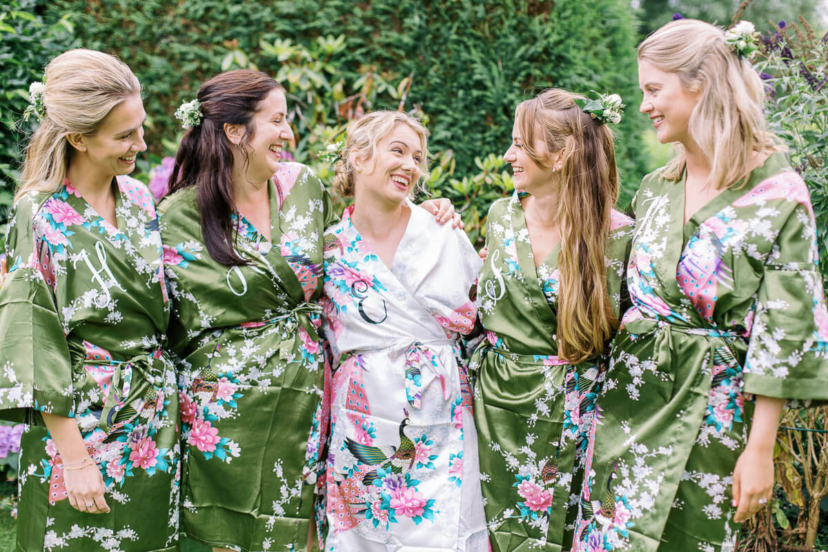 fun and relaxed photo of the bride and her bridesmaids