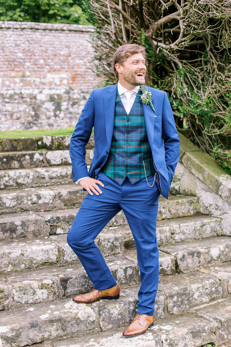 the groom style wearing blue colour suit