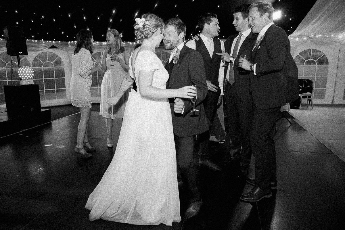 timeless black and white photo of the bride and groom dancing