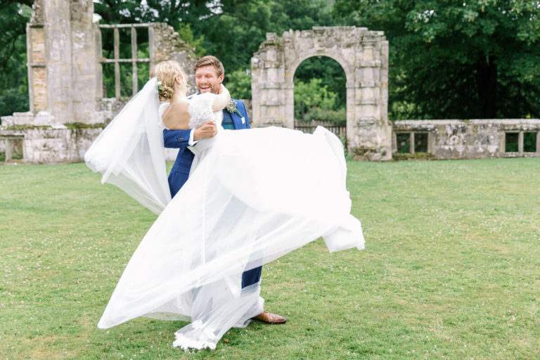 relaxed and fun wedding photo of the bride and groom dancing
