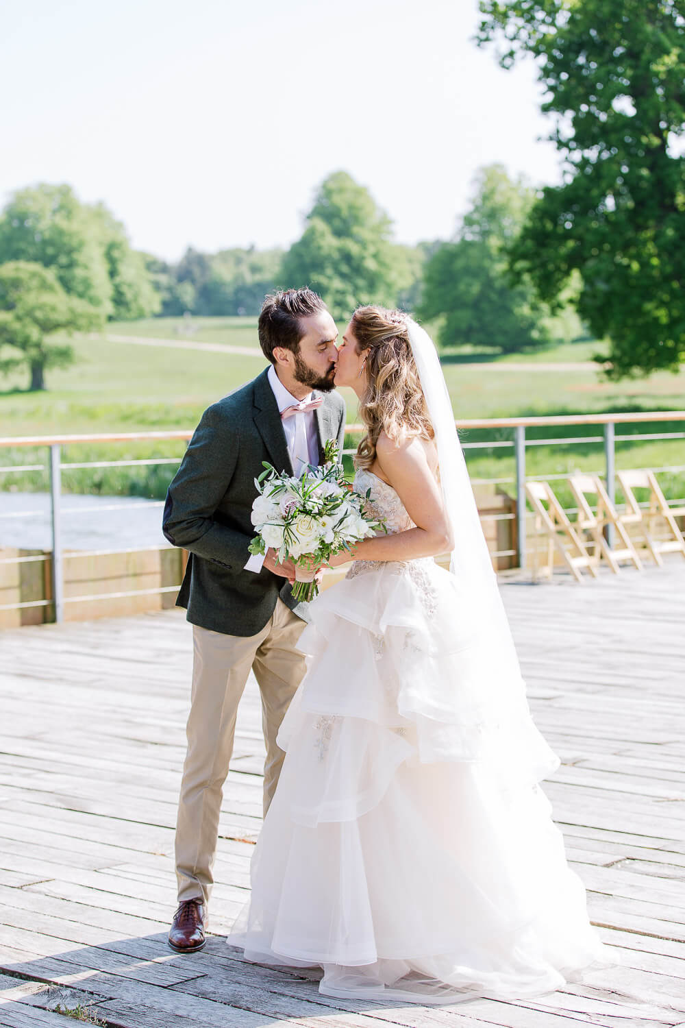 bride and groom kissing photo at barn wedding in Suffolk
