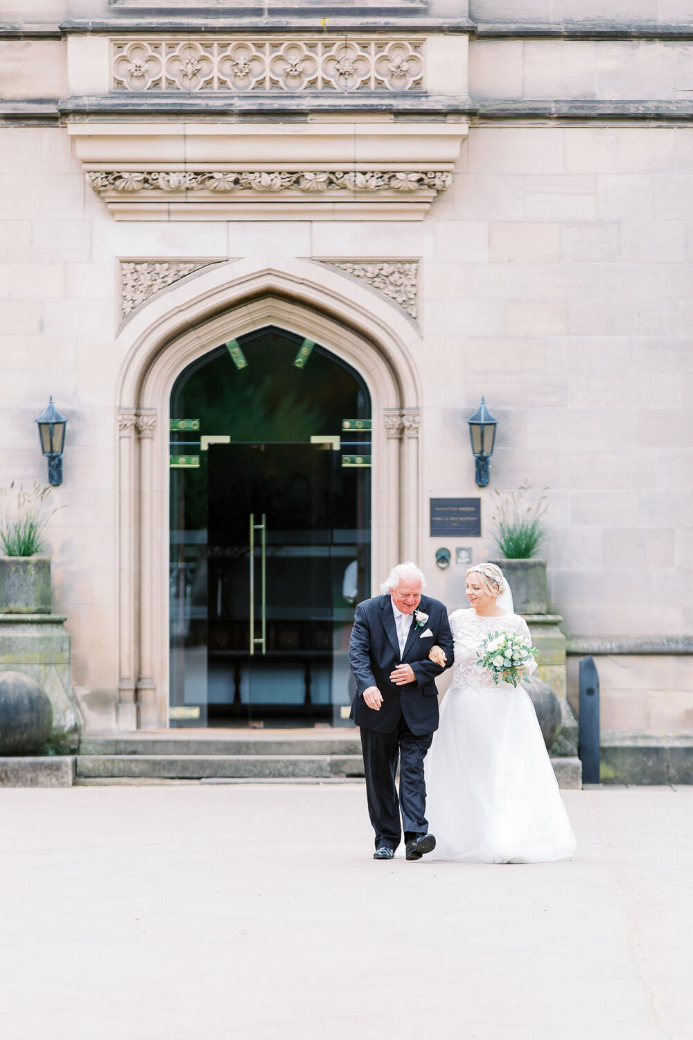 the bride and father walking down to the wedding ceremony at Hampton manor in solihull