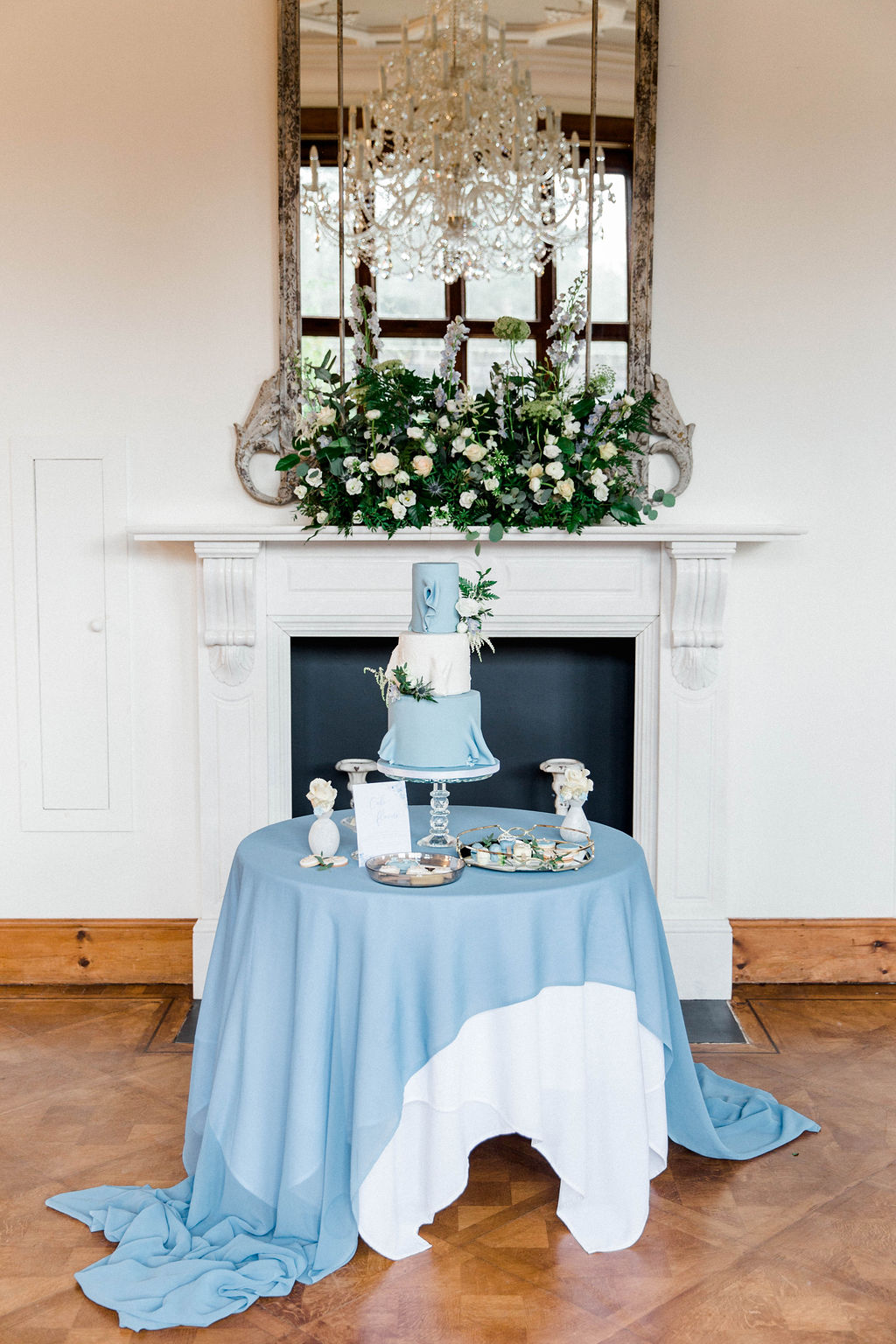 three tier wedding cake in dusky blue and white