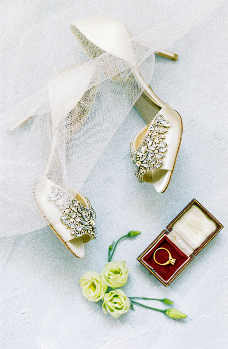 flat lay styling with shoes and engagement ring