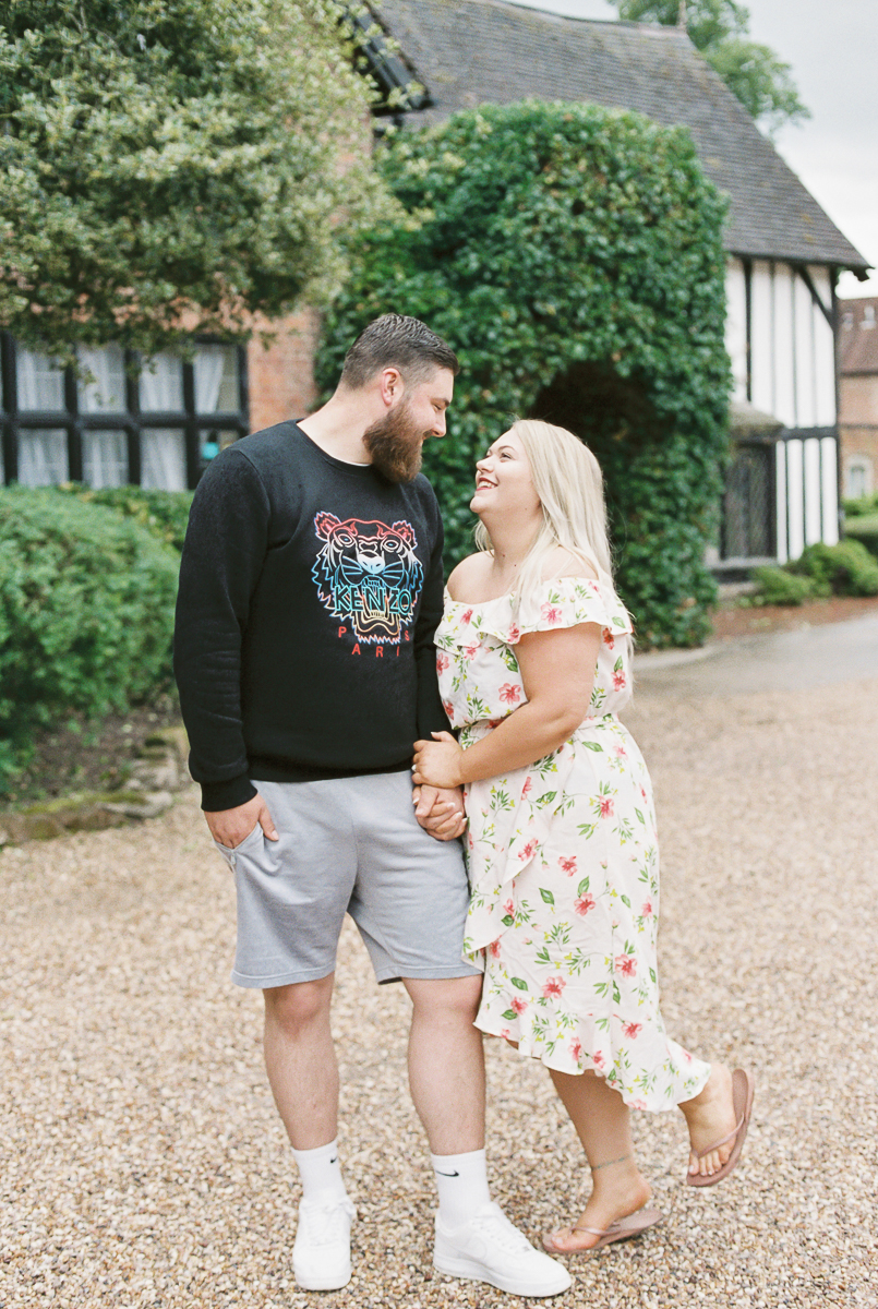 bride to be and fiance at their engagement photo session in nailcote hall hotel
