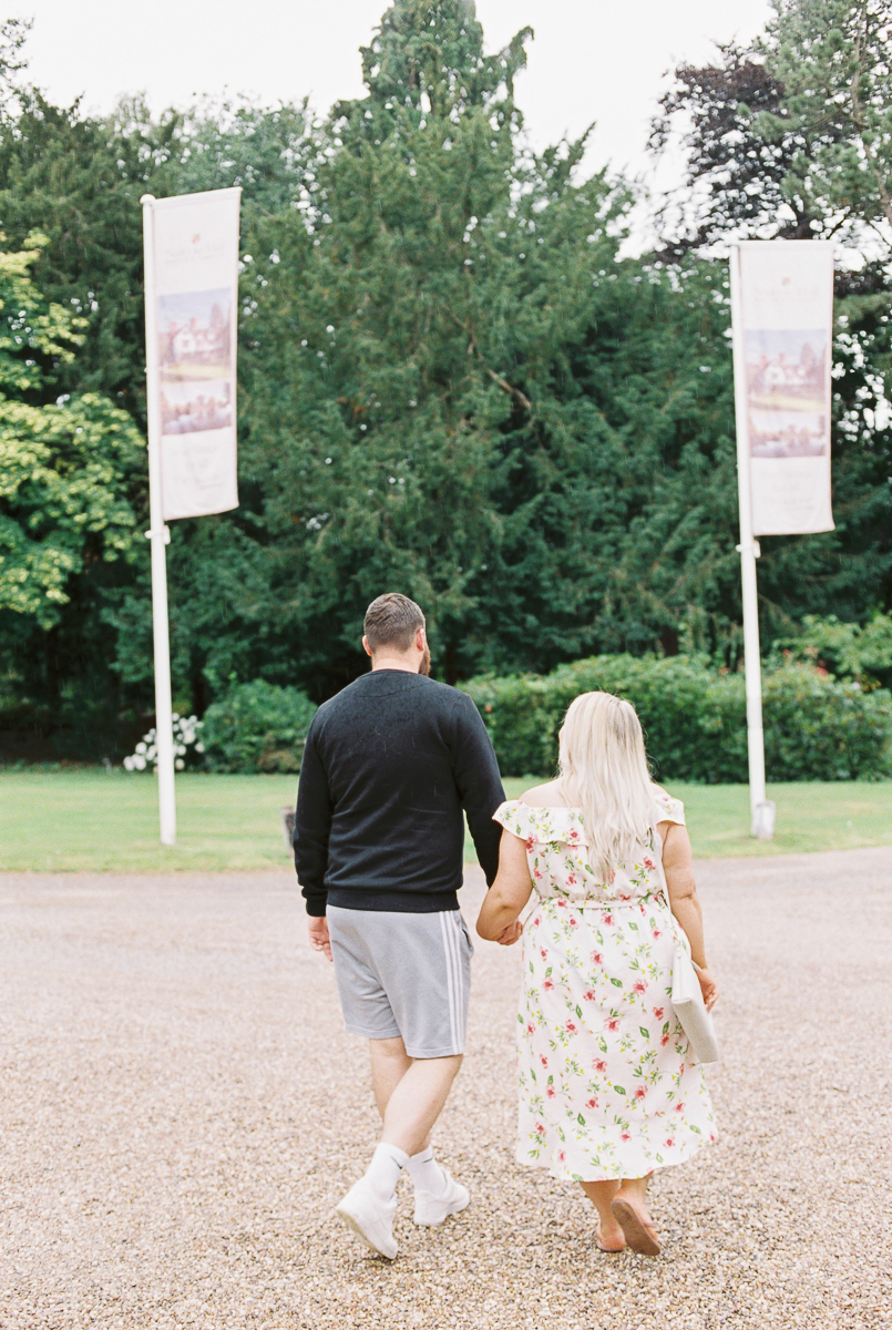 couple walking hand to hand during engagement photo session