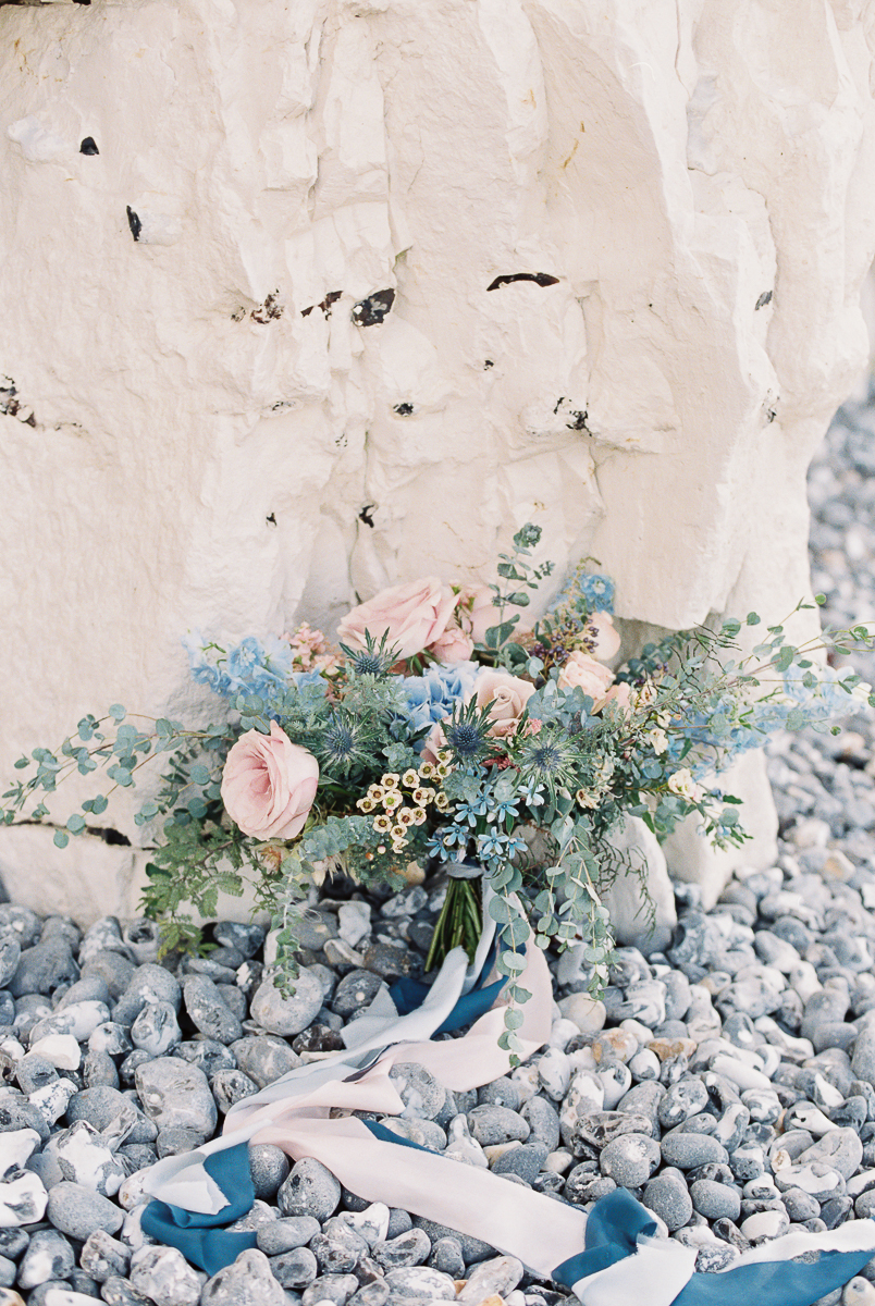 wedding brides bouquet in blue and pink colours