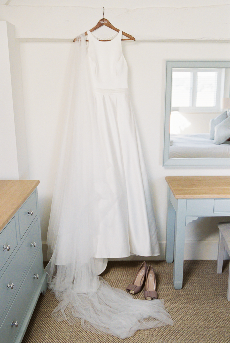 the wedding gown and shoes photo