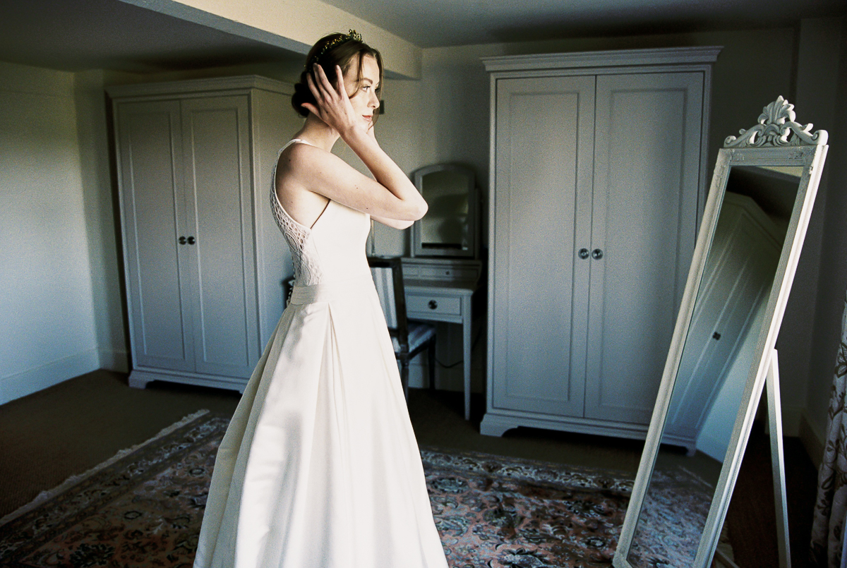 the bride looking in the mirror