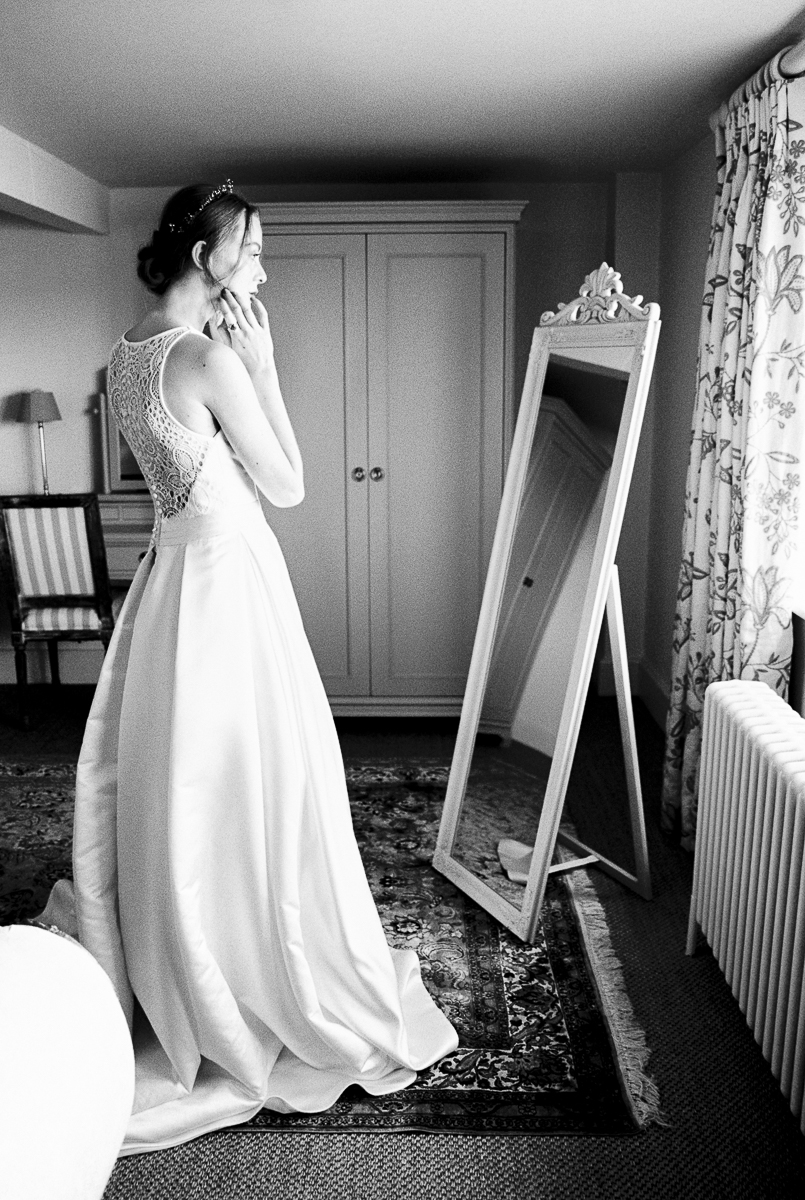 the bride getting into the dress
