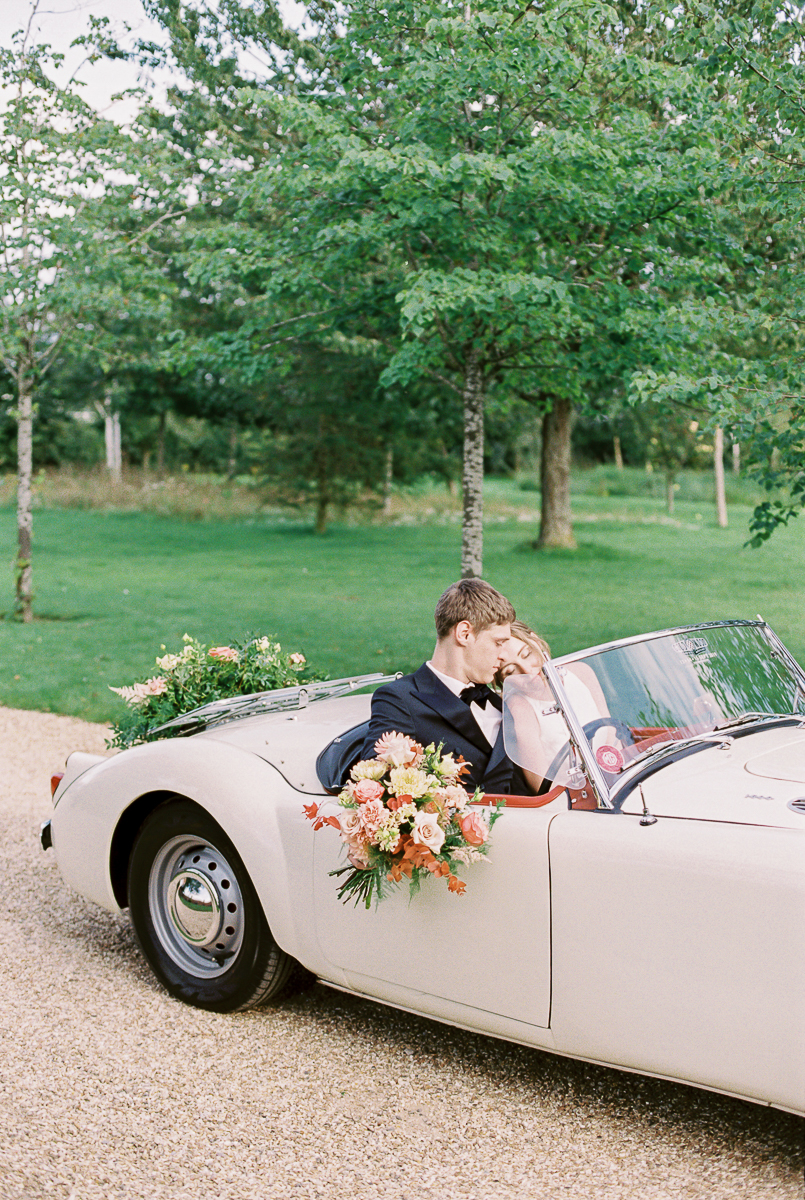 couple in the car at their wedding