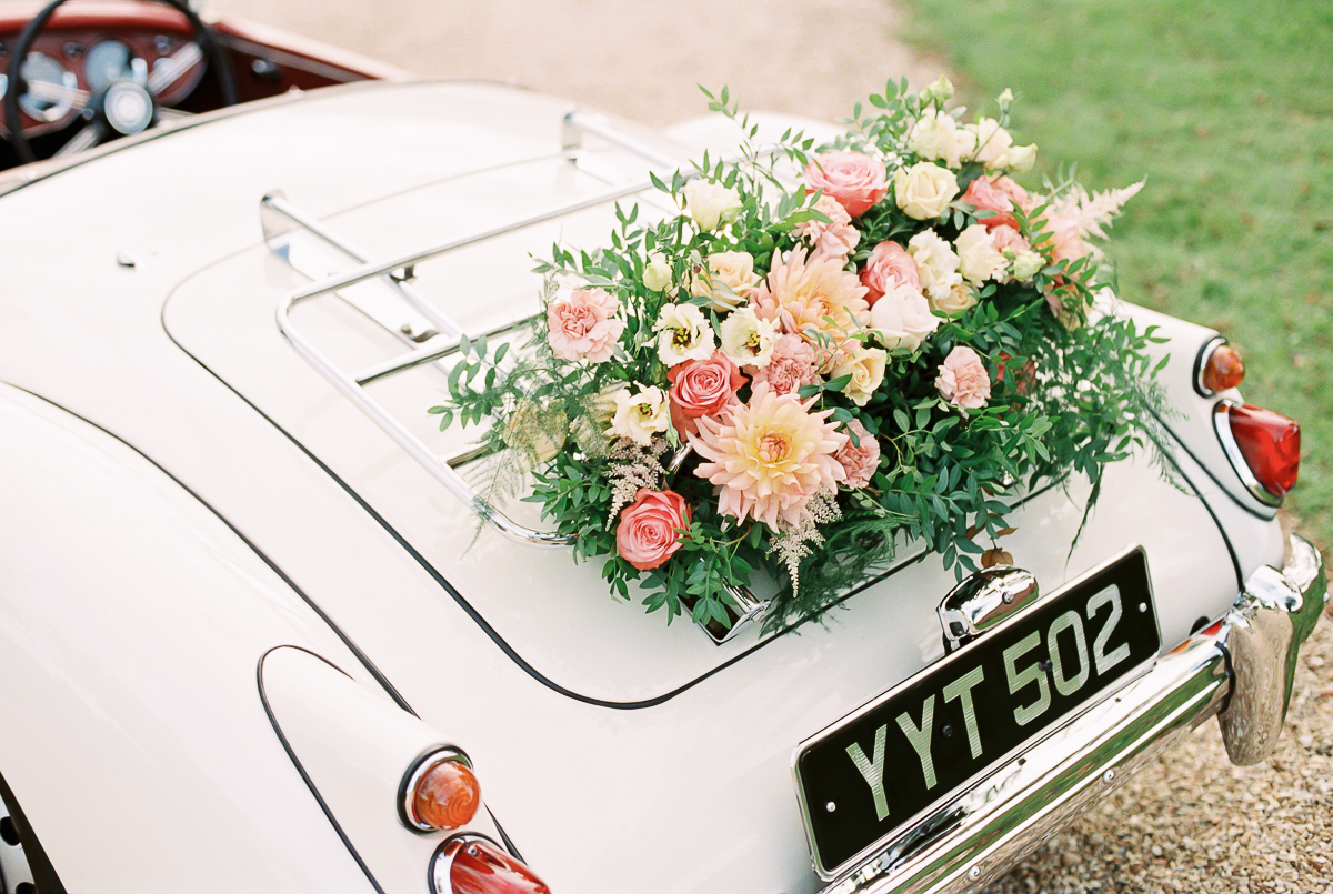 wedding car florals in coral and pink